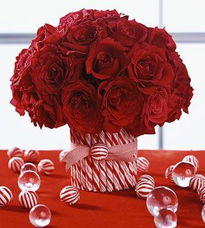 candy cane vase filled with roses for christmas decor