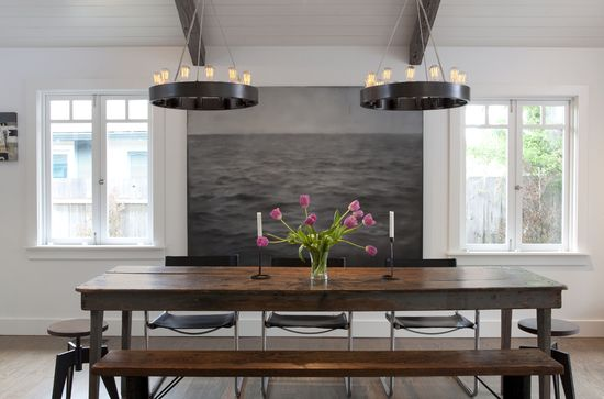 Modern rustic dining room: Modern art, dark metal chandelier, modern black leather and chrome chairs, reclaimed wood table and bench, industrial stools  Mill Valley -