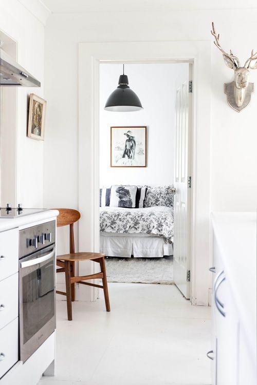 Sneak Peek, Best of: Black & White - Positioned against a white-wall backdrop, a black pendant light hangs like a punctuation mark in Annabelle Kerslake's bedroom. #sneakpeek #blackandwhite