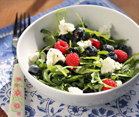 Antioxidant-rich arugula, berries and goat cheese salad with poppy seed dressing.