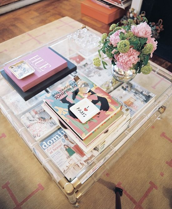 nicely layered, large acrylic coffee table with pops of pink