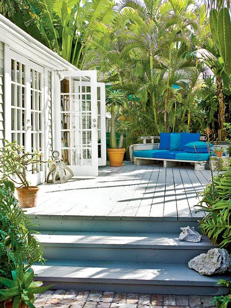 the deck, french windows lush garden & the beautiful blue.