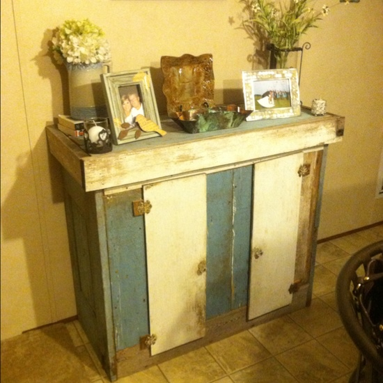 The vintage table my husband made from a door and kitchen cabinets from an old home. :) - beautiful! :)