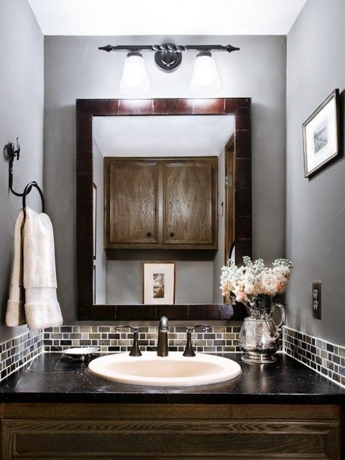 """Mix brown with gray to keep the bathroom feeling """"warm""""."""