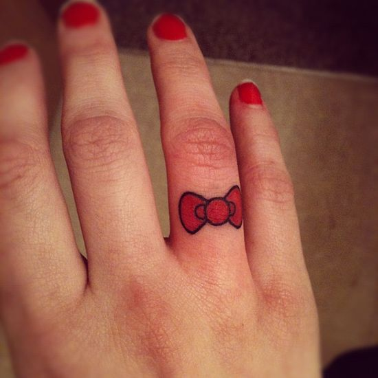 Hello Kitty bow because I like HK and wanted a cute finger tattoo. Simple. Done