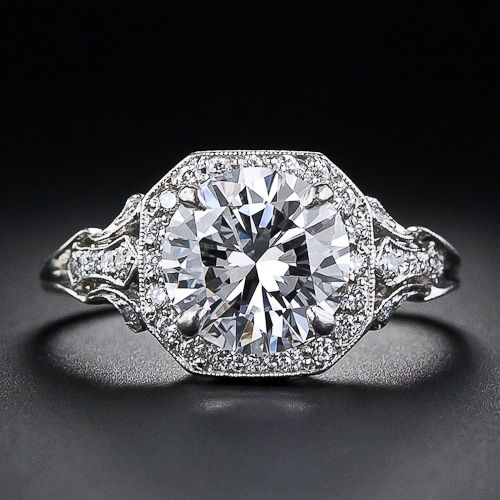 2.17 Carat 'D' color diamond Edwardian style engagement ring at Lang Antiques. A superb 2.17 carat round brilliant-cut diamond - accompanied by a GIA Gem Trade Laboratory grading report stating D color, VS2 clarity- is framed by small sparkling accent diamonds atop a fancy scroll motif gallery and openwork foliate motif diamond-set shoulders.  Via Diamonds in the Library.