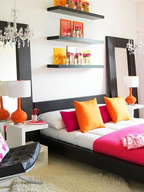 Pink and Orange bedroom with black and white furniture