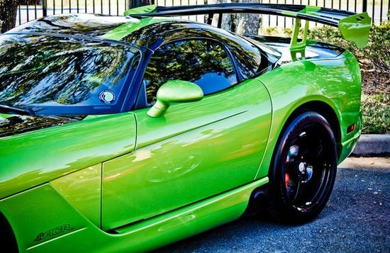 Vibrant neon green Dodge Viper sports car with an awesome spoiler in back.