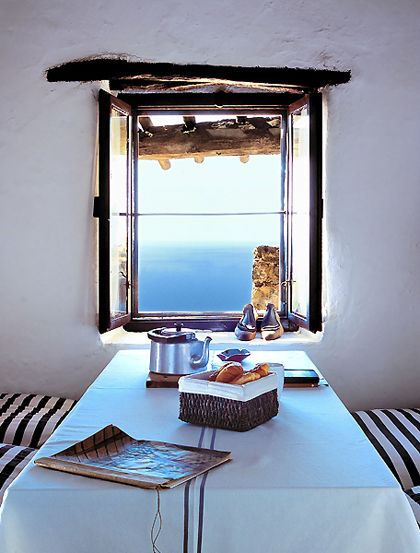 wall, window, tea on a tablecloth, and ocean view and breeze... yes, please.