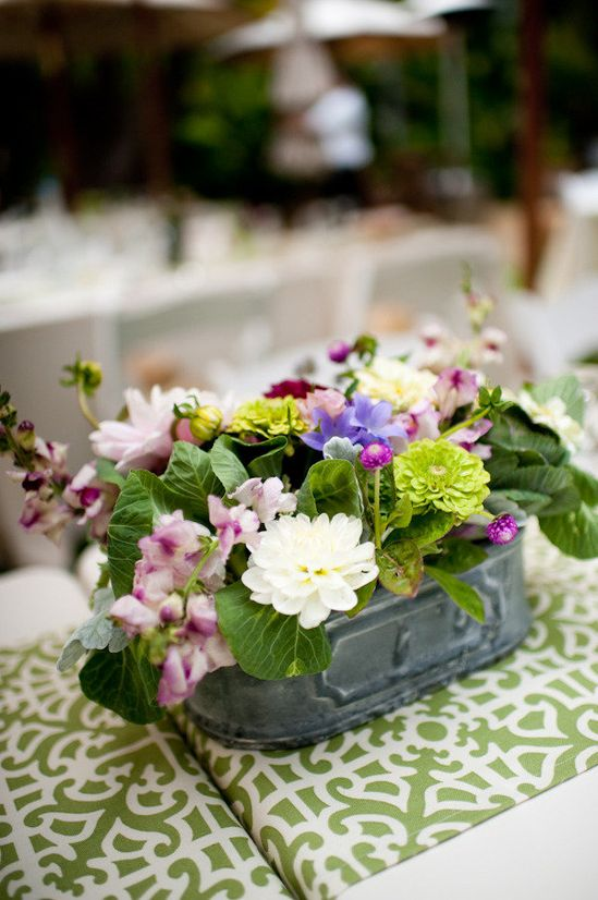 floral centerpiece in a galvanized bucket.