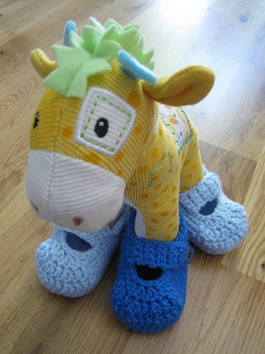 Really I'm pinning these JUST for this photo!  But the booties pattern is here t