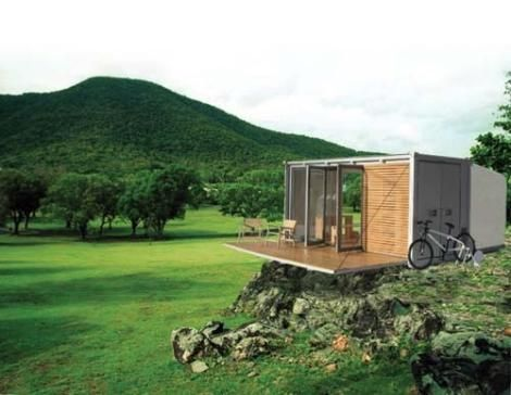 The All Terrain Cabin (ATC) By BARK.  Small scaled prefab shipping container gre