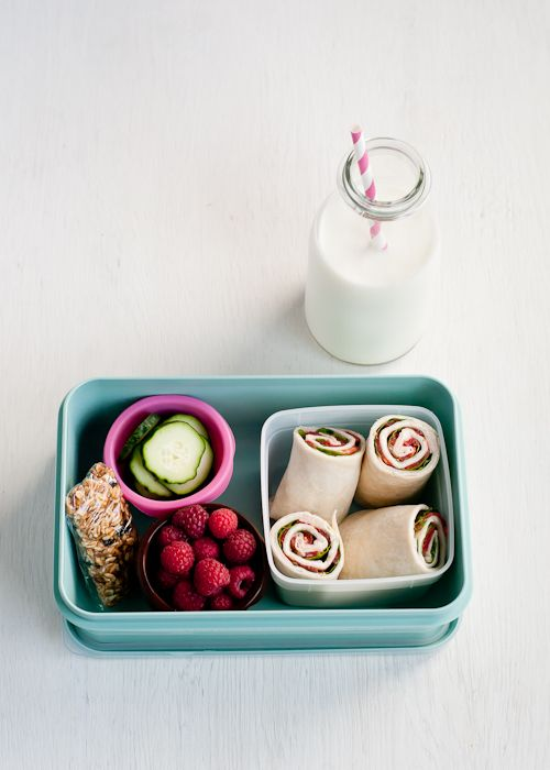 "- Turkey Wrap – large  tortilla spread with a thin layer of cream cheese and a single layer of: deli turkey, baby spinach, sliced fresh tomato - Fresh raspberries - Cucumber ""chips"" - Homemade granola bar - Milk"