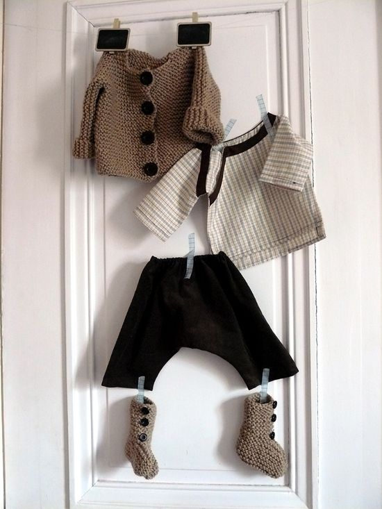 hang baby clothes on wall framed. also super cute w/just baby socks.