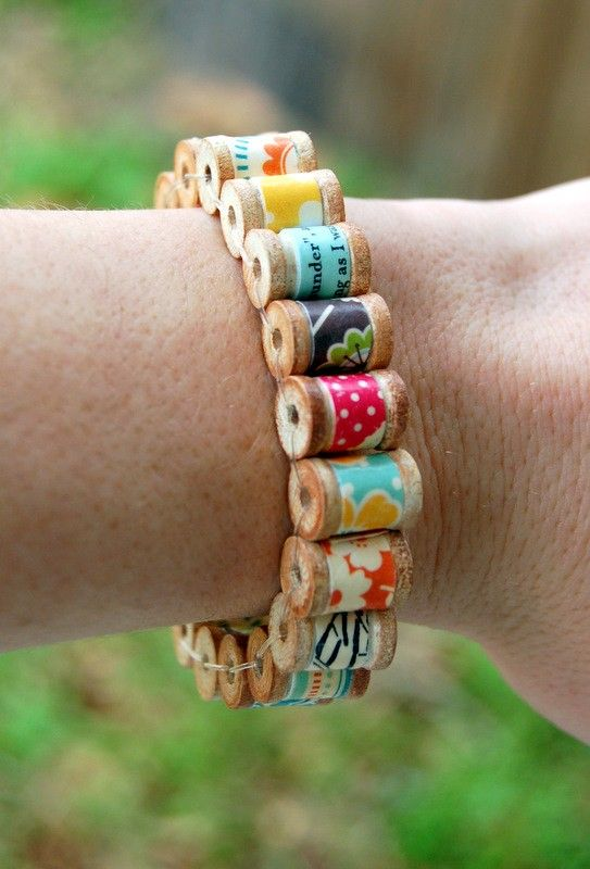 bracelet of tiny wooden spools... so clever and cute!