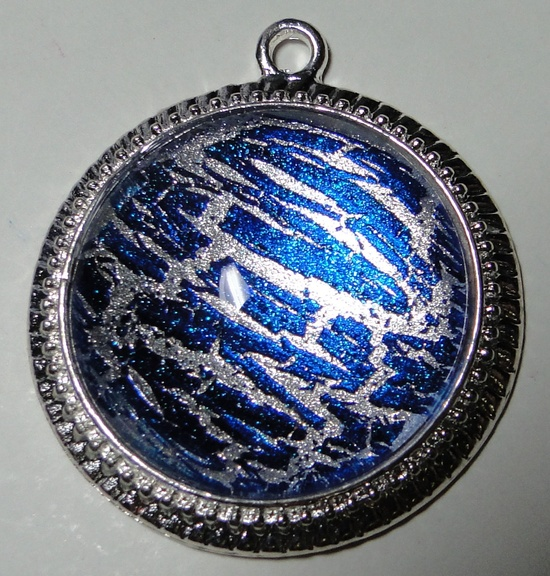 Blue Shatter over Silver with Sparkle - 1'' Circle Nail Polish Jewelry Pendant. $8.00, via Etsy.