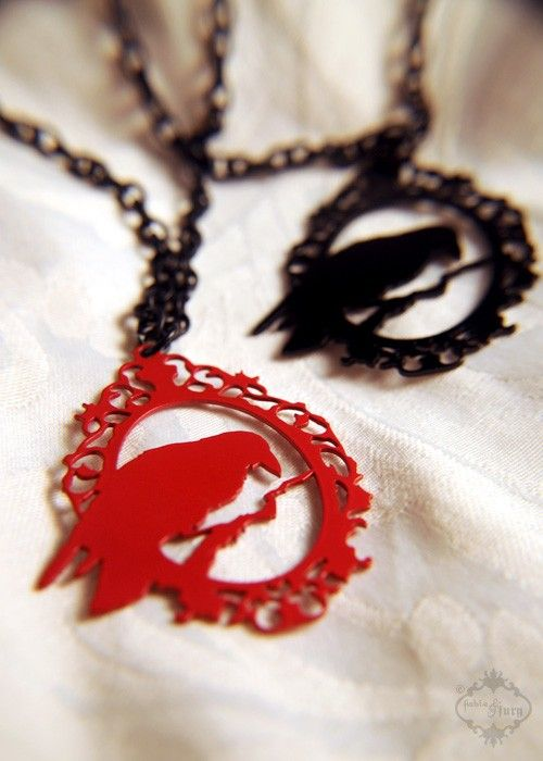 Perched Raven Cameo silhouette necklace in red stainless steel.