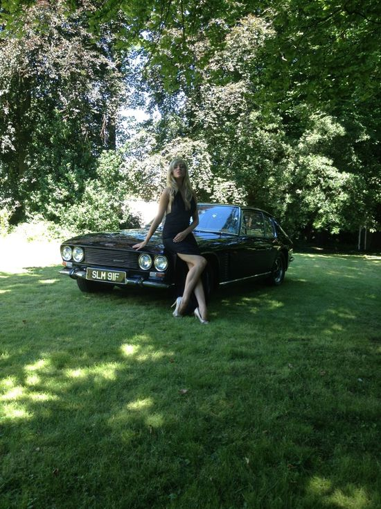 Supermodel Harriadnie Beau draped atop a Jensen Interceptor.