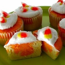 Colorful candy corn cupcakes: the kids will love the surprise orange inside this yummy cupcake that is very easy to make. It is also a recipe...