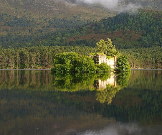 Castle ruins on Loch an Eilein, one of the most beautiful lochs in the Scottish Highlands in the Cairngorms.