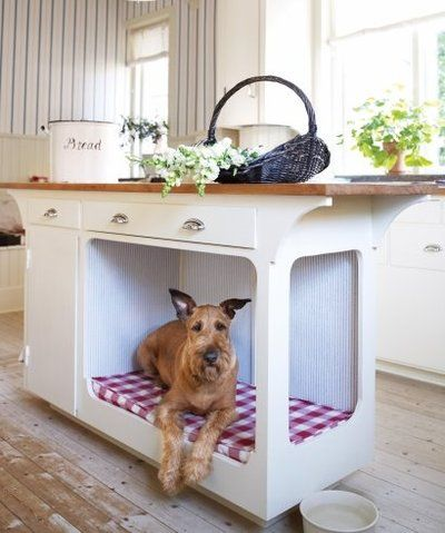 Built-in dog beds in kitchen cabinets