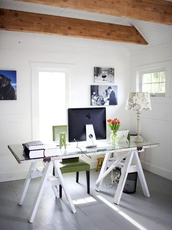DIY Desk: Salvaged Sawhorses and Door, covered with a sheet of glass. (So easy and inexpensive!) --> www.hgtv.com/...