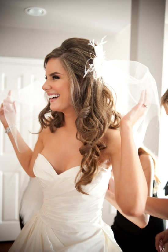 wedding hair half up half down. I actually just love that dress!