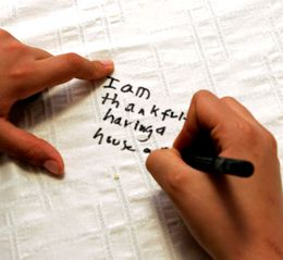 This would be a great family tradition! Have everyone write what they are thankful for on a cloth tablecloth on Thanksgiving. Bring it out every year and add to it. Love this idea! What a treasure this would be!