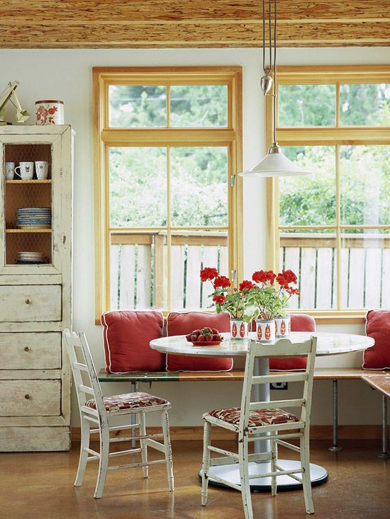 Cottage Chic...red accents, open benches, distressed white...