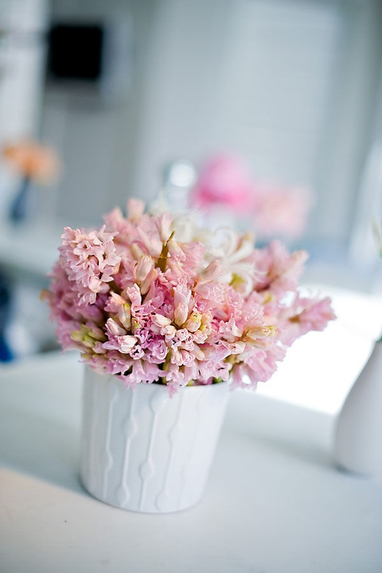 white vases filled with colorful flowers Photography by www.augiechang.com