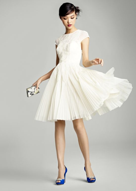 Love this textured LWD (little white dress!) with a swingy skirt and blue shoes.