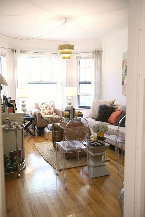 Colette Conway's Lincoln Park Apartment Tour // living room // lucite chair // jute rug // x bench side tables // barcart // Chicago // natural light // small space // decorating on a budget // #decor // #eclectic // Photography by Coach House Pictures