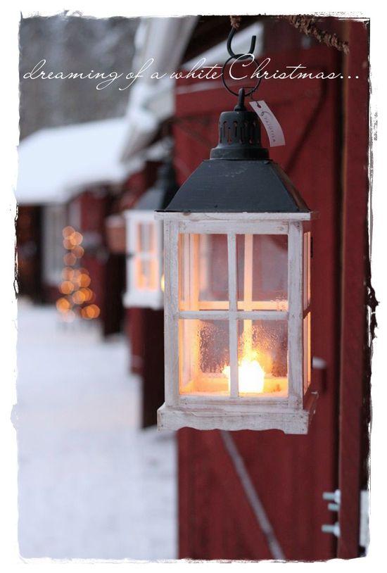 Prim White Christmas...lanterns glowing in the snow.
