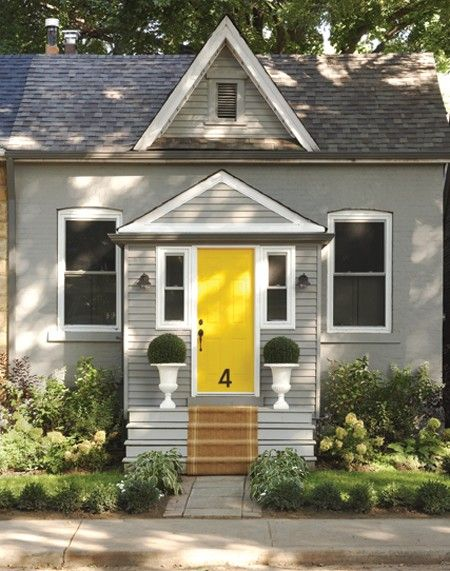 trim colour, Kendall Charcoal (HC-166) and Distant Gray (OC-68), siding colour, Chelsea Gray (HC-168), door colour, Lemon (2021-20), Benjamin Moore; platinum gray solid exterior stain, Benjamin Moore; house number, Wattle & Daub, (416) 465-1355; planters, Bliss Interior Design; siding, roof, Synergy.