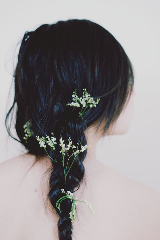 Such a beautiful braided hairstyle I'd like to try someday. I adore the flowers woven in the braid.