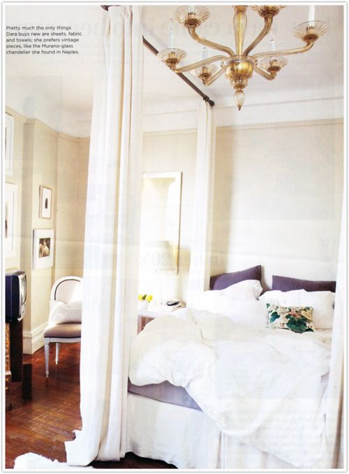 Use curtain rods to create a canopy bed! Genius.
