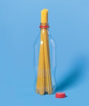 Fill the mouth of a dry 20-ounce bottle with uncooked spaghetti; the opening holds enough for a hearty single serving.