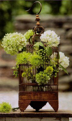 flowers in a bird cage table setting