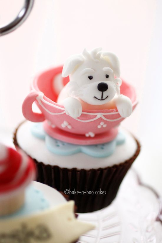 Dog in cup cupcake