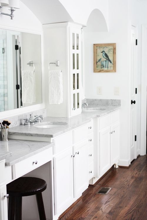 His and hers sinks with cabinet in between.