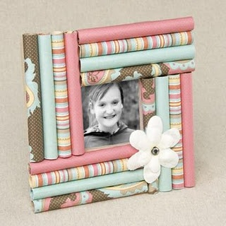 do it yourself gift wrap photo frame!  You roll little tubes of gift wrap and glue them on to cardboard.  Easy!