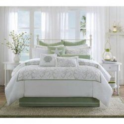 Decorating a beach themed bedroom starting with beach bedding. Several decoratin
