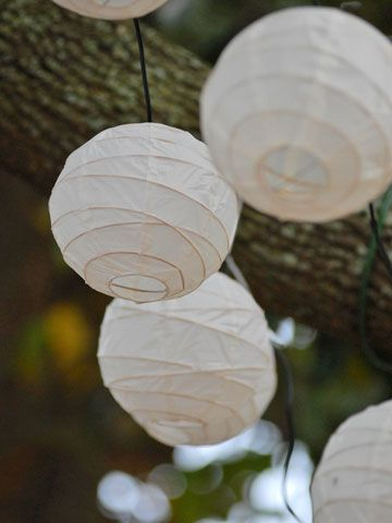 Paper lanterns give this reception a romantic glow. See the rest of this gorgeous wedding: www.bhg.com/...