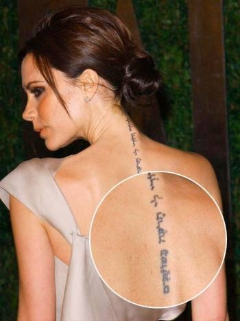 "Victoria Beckham's back tattoo in Hebrew says, ""I am my beloved, and my beloved is mine"""