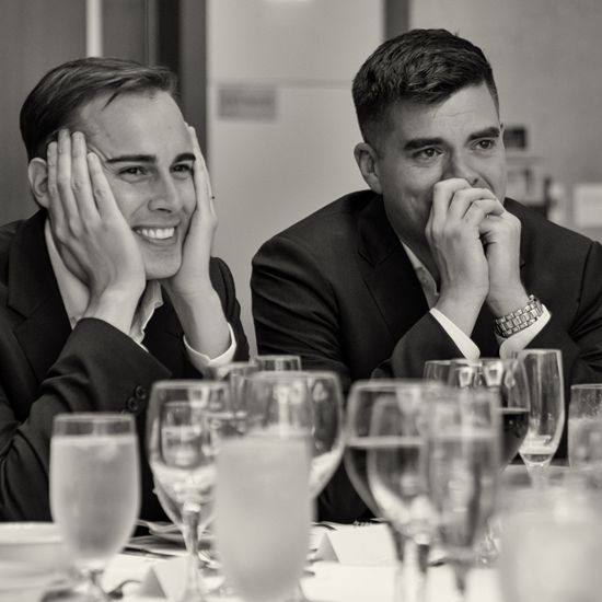 We all get emotional during wedding toasts! Right? Sean True Photography caught these happy grooms cheesing during their special day.