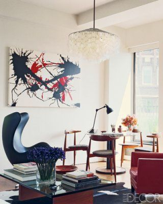 In the dining area, the painting is by Joseph La Piana and the light fixture is by Verner Panton; the Arne Jacobsen Egg chair, Hans J. Wegner dining chairs, and Edward Wormley dining table are all vintage pieces that were found at Wyeth.