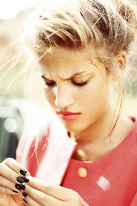 sassy nails, classy jacket, messy bun. i like this girl.