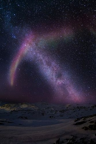 The Aurora and the Milky Way cross over  each other resulting in the mesmerizing display of a stellar rainbow.