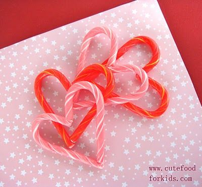 Candy Cane Hearts -   Bake them in 250 degree F preheated oven until the end parts starting to melt (about 6 to 7 minutes).  Immediately after you get them out of the oven, press the connecting parts together gently by hands ( don't worry, they are not that hot).