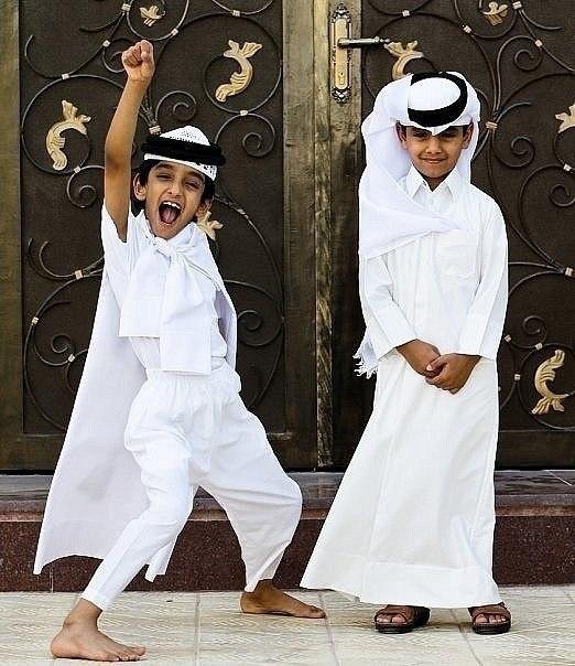2 Arab boys playing superman!
